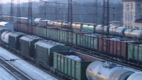 Many railways with freight trains on station at winter. Day stock footage