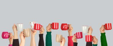 Many raised hands up with ceramic cups on a white background. Recruitment concept, join our team royalty free stock photography