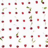 Many raspberries and cherries arranged on square Stock Photos