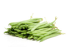 Many raw green  beans. Isolated over white Royalty Free Stock Photo