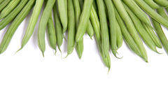 Many raw green  beans. Isolated over white Royalty Free Stock Photography