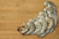 Many Raw Green King Size Shrimps On Wooden Background Royalty Free Stock Images