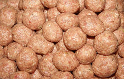 Many Raw Meatballs. A plate piled with raw meatballs Stock Photo