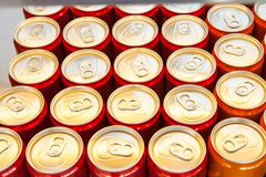 Many aluminum cans with drinks top view royalty free stock image