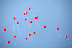 Many red balloons in the sky Royalty Free Stock Images