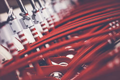 Many red bicycles. City bikes are neatly lined up and ready for rent. Image showing detail and is mainly red colored Royalty Free Stock Images
