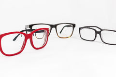 Many red and black eyeglasses. With white background Royalty Free Stock Photos