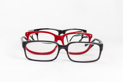 Many red and black eyeglasses. With white background Royalty Free Stock Images