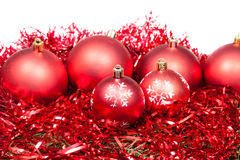 Many red Christmas balls and tinsel isolated Royalty Free Stock Images