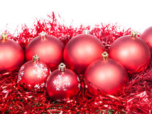 Many red Christmas baubles and tinsel isolated Royalty Free Stock Image
