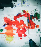 Many red colored blots on white paper with streaks Stock Photo