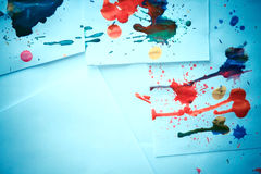Many red colored blots on white paper with streaks Stock Photography