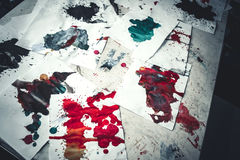 Many red colored blots on white paper with streaks Royalty Free Stock Image