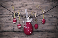 Many Red Easter Eggs And One Big Egg Hanging On Line Frame Stock Images