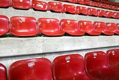 Many red empty seats in the stadium. Many red empty seats in the ice stadium Royalty Free Stock Image