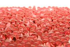 Many red gel marbles on white Stock Photos
