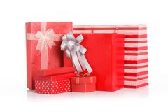 Many Red gift boxes with red shopping bag Royalty Free Stock Images