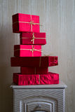 Many Red Gifts on the nightstand. Royalty Free Stock Photo
