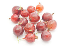 Many red gooseberries on white. Many tasty red gooseberries on white background closeup Royalty Free Stock Photography