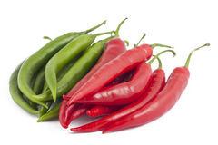 Many red and green chili peppers on white. Background Royalty Free Stock Photo