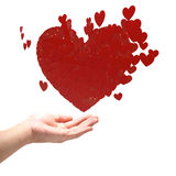 Many red hearts on hand. Stock Image