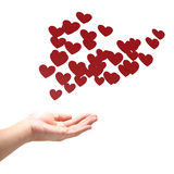 Many red hearts on hand. Royalty Free Stock Photography