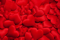 Many red hearts. Many red silk hearts - valentine background Royalty Free Stock Image
