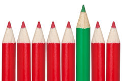 Many red pencils and one green Royalty Free Stock Photos