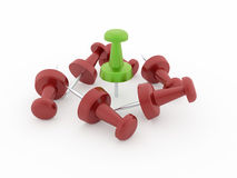 Many red push pins one is green isolated Stock Photography