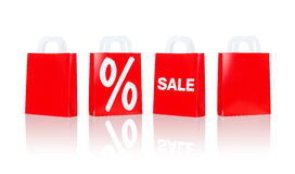Many red shopping bags with sale and percentage Stock Image