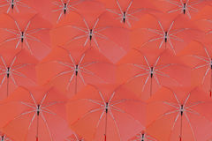 Many red umbrella concatenation. Royalty Free Stock Photos