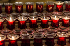 Many red votive candles. View of many red votive candles royalty free stock image