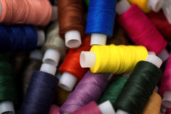 Many reels of threads for embroidery. Stock Photos