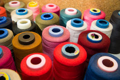 Many reels of  threads standing on the table Stock Photography