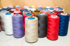 Many reels of  threads standing on the table Royalty Free Stock Photo