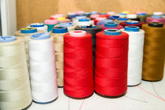 Many reels of  threads standing on the table Royalty Free Stock Photos