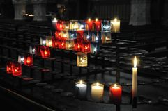 Many religious candles on a black support Royalty Free Stock Photo