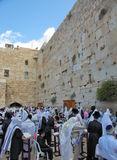 Many religious Jews  gathered for prayer. JERUSALEM, ISRAEL - SEPTEMBER 20, 2013:The Western Wall of the Temple in Jerusalem. Morning Sukkot. Many religious Royalty Free Stock Images