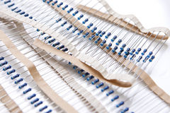 Many Resistors On Tape. Isolated Over White Stock Photos