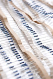 Many Resistors On Tape. Isolated Over White. Royalty Free Stock Image