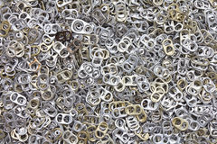 Many ring pull can opener. Background of many ring pull can opener, silver and gold royalty free stock photography