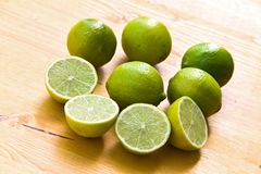 Many Ripe Limes On A Cutting Board Royalty Free Stock Image