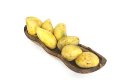 Many ripe mango in wood bow stock photo