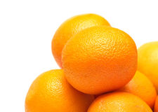 Many ripe oranges closeup isolated on white Stock Images