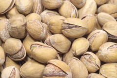 Many ripe pistachios closeup. Many ripe salty pistachios closeup Royalty Free Stock Images