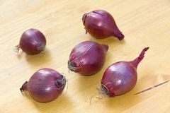 Many Ripe , Red Onions On A Wooden Background Stock Photo