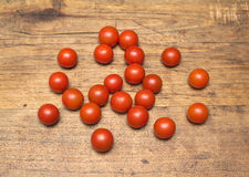 Many ripe red tomatoes lies on wooden surface Royalty Free Stock Photography