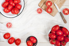 Many ripe red tomatoes on the wooden table Stock Photography