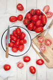 Many ripe red tomatoes on the wooden table Stock Image