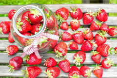 Many ripe strawberry in glass jar. Summer bounty. Royalty Free Stock Photos